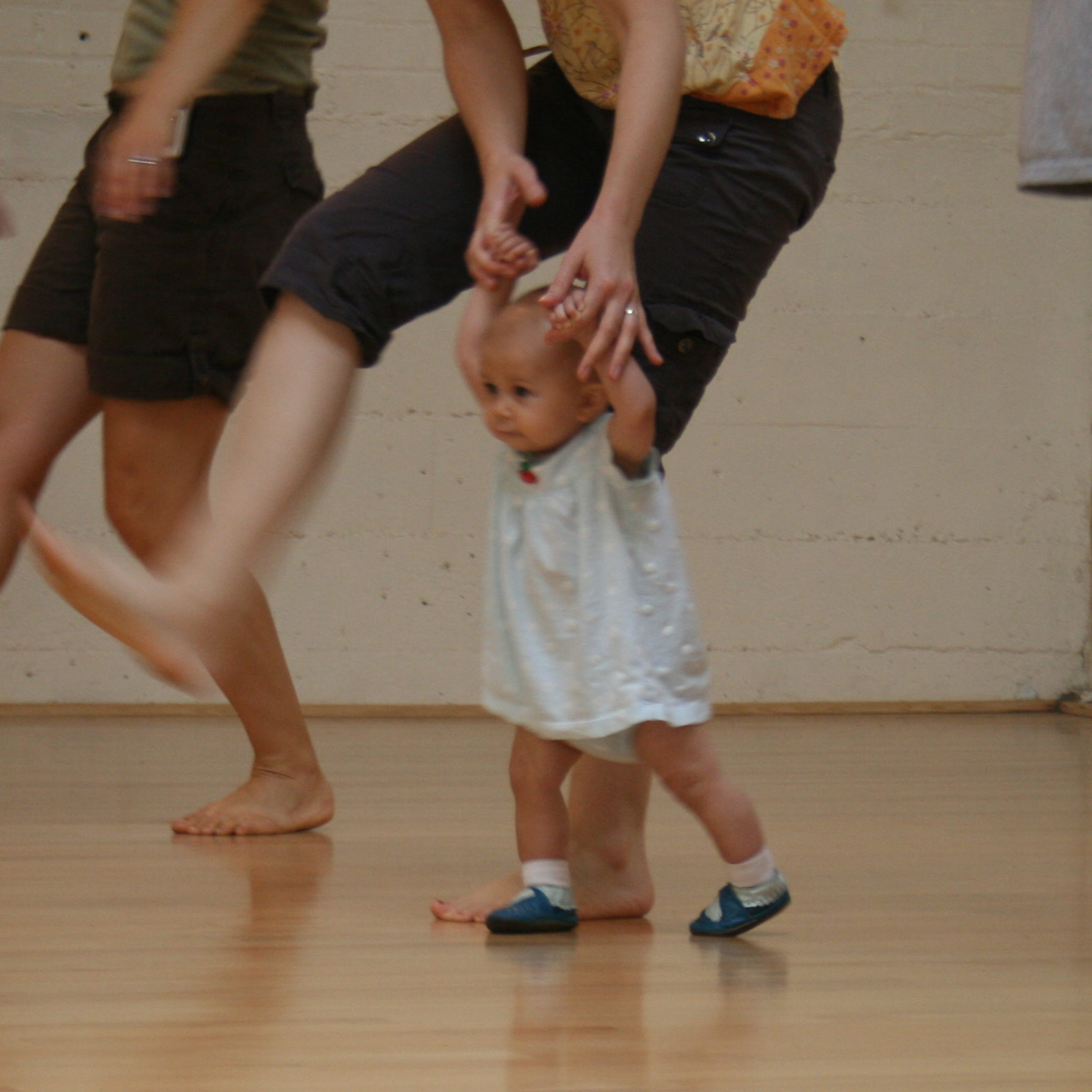 Infant-among-adult-legs-cropped